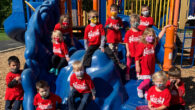 Preschool Students on Playground Equipment with Safety Masks